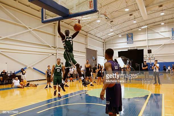 Thon Maker of the Milwaukee Bucks dunks the ball during the 2016 NBA rookie photo shoot on August 7 2016 at the Madison Square Garden Training...