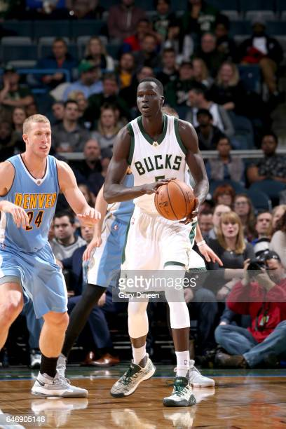 Thon Maker of the Milwaukee Bucks handles the ball against the Denver Nuggets on March 1 2017 at the BMO Harris Bradley Center in Milwaukee Wisconsin...