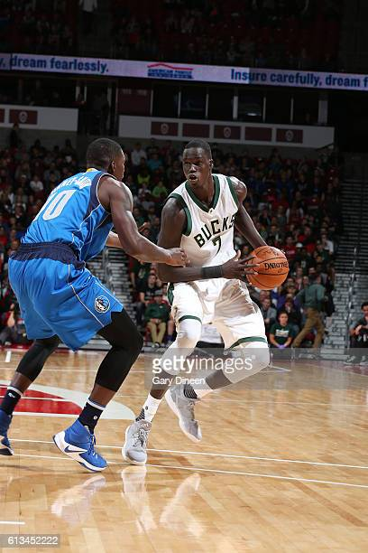 Thon Maker of the Milwaukee Bucks handles the ball during a preseason game against the Dallas Mavericks on October 8 2016 at the Kohl Center in...