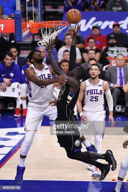 Thon Maker of the Milwaukee Bucks lays up a shot and gets fouled by Joel Embiid of the Philadelphia 76ers during the second half of the game at Wells...