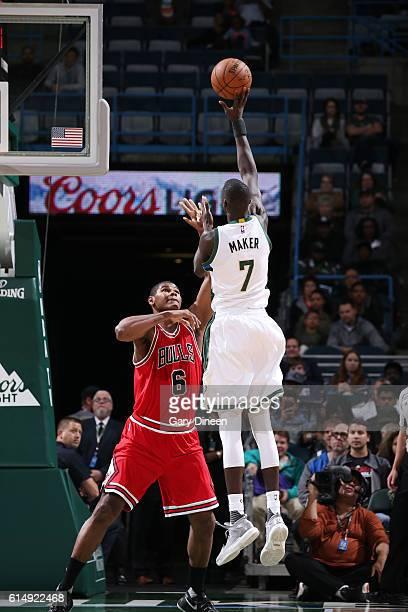 Thon Maker of the Milwaukee Bucks shoots the ball against Cristiano Felicio of the Chicago Bulls on October 15 2016 at the BMO Harris Bradley Center...