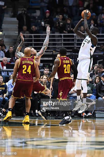 Thon Maker of the Milwaukee Bucks takes a shot during a game against the Cleveland Cavaliers at the BMO Harris Bradley Center on November 29 2016 in...