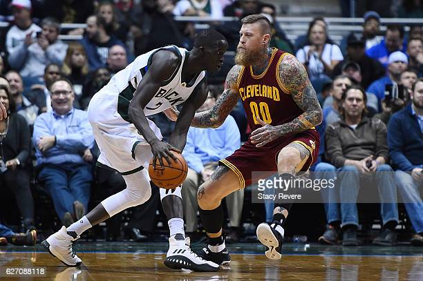 Thon Maker of the Milwaukee Bucks works against Chris Andersen of the Cleveland Cavaliers during a game at the BMO Harris Bradley Center on November...