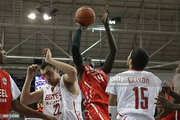 TORONTO APRIL 14 Thon Maker sticks with it for the put back as Jerome Desrosiers and Eddie Ekiyor try to play defence The Biosteel All Canadian...