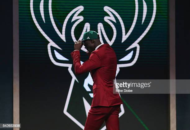 Thon Maker walks on stage after being drafted 10th overall by the Milwaukee Bucks in the first round of the 2016 NBA Draft at the Barclays Center on...