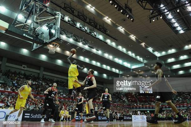 Thon Marial Maker of Australia dunks during the FIBA World Cup Asian Qualifier Group B match between Japan and Australia at Chiba Port Arena on June...