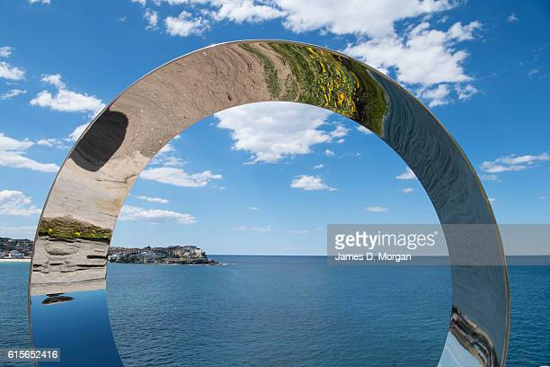 Thong vs Sandfly by artist Jane Gillings is seen after it was damaged last night by a king tide at Sculpture By The Sea at Tamarama Beach on October...