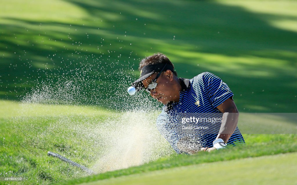Thongchai Jaidee of Thailand and the International Team plays his fourth shot on the third hole in his match with Charl Schwartzel against Bill Haas and Chris Kirk of the United States team during the Friday four-ball matches at The Presidents Cup at Jack Nicklaus Golf Club Korea on October 9, 2015 in Songdo IBD, Incheon City, South Korea