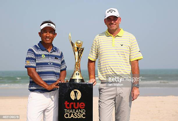 Thongchai Jaidee of Thailand and Thomas Bjorn of Denmark pose for the media to promote the Thailand Classic golf event on the beach outside the...