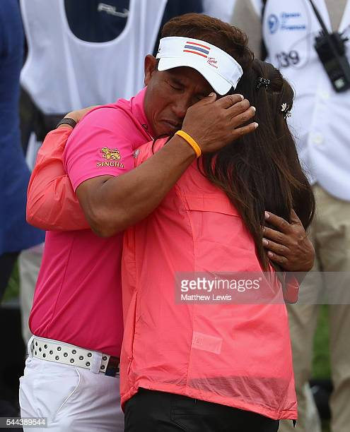 Thongchai Jaidee of Thailand celebtrates his win with his wife during day four of the 100th Open de France at Le Golf National on July 3 2016 in...