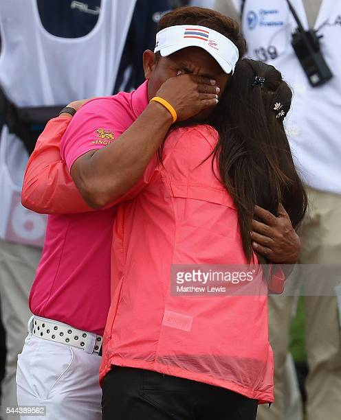 Thongchai Jaidee of Thailand celebtrates his win with his wife during day four of the 100th Open de France at Le Golf National on July 3, 2016 in...