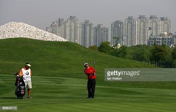 Thongchai Jaidee of Thailand in action on the 15th hole during the first round of the BMW Asian Open at the Tomson Shanghai Pudong Golf Club on April...