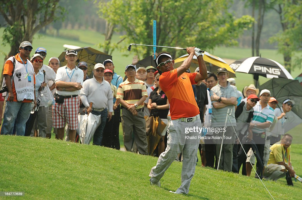 Thongchai Jaidee of Thailand plays a shot during round one of the Chiangmai Golf Classic at Alpine Golf Resort-Chiangmai on March 28, 2013 in Chiang Mai, Thailand.