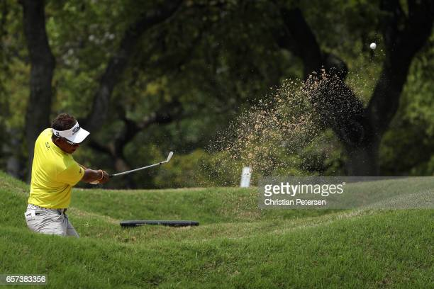 Thongchai Jaidee of Thailand plays a shot from a bunker on the 6th hole of his match during round three of the World Golf Championships-Dell...