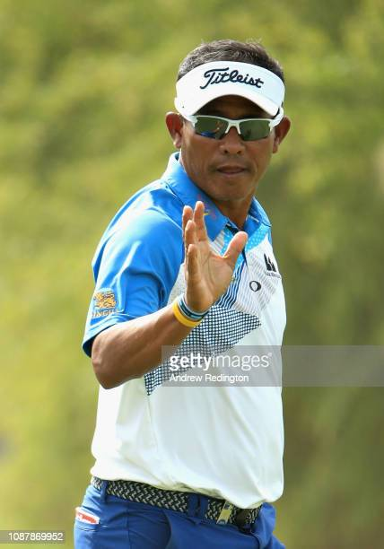 Thongchai Jaidee of Thailand reacts to a birdie putt on hole seventeen during Day One of the Omega Dubai Desert Classic at Emirates Golf Club on...