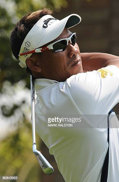 Thongchai Jaidee of Thailand tees off before finishing the day at 1 under par during the BMW Asian Open golf championship in Shanghai on April 24,...