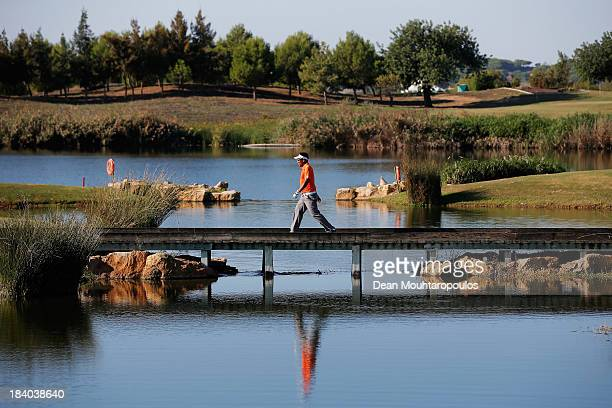 Thongchai Jaidee of Thailand walks on the bridge on the 14th hole during the second round of the Portugal Masters at Oceanico Victoria Golf Course on...