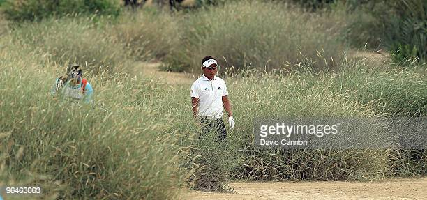 Thongchai Jaidee of Thailand walks to his second shot at the 16th hole during the third round of the 2010 Omega Dubai Desert Classic on the Majilis...
