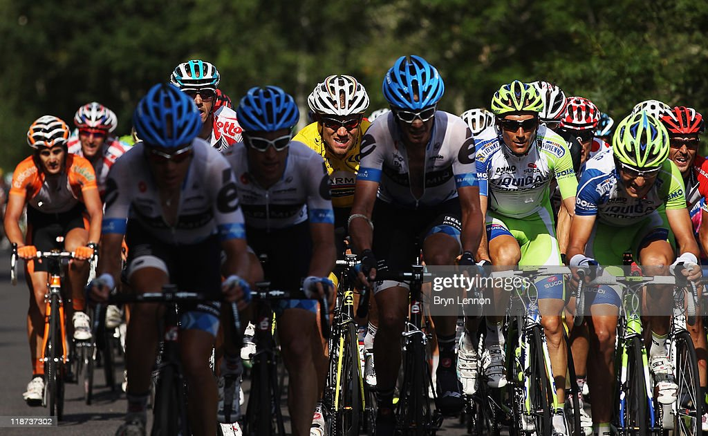 Thor Hushovd of Norway and Team Garmin-Cervelo (centre) rides in the peloton on stage nine of the 2011 Tour de France from Issoire to Saint Flour on July 10, 2011 in Saint-Flour, France.