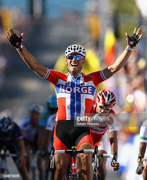 Thor Hushovd of Norway celebrates as he crosses the line to win the Elite Men's Road Race on day five of the UCI Road World Championships on October...