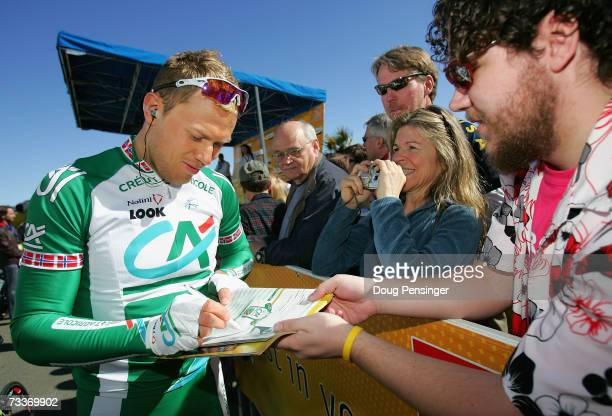 Thor Hushovd of Norway, riding for Credit Agricole, signs autographs for fans before the start of Stage 1 of the AMGEN Tour of California on February...