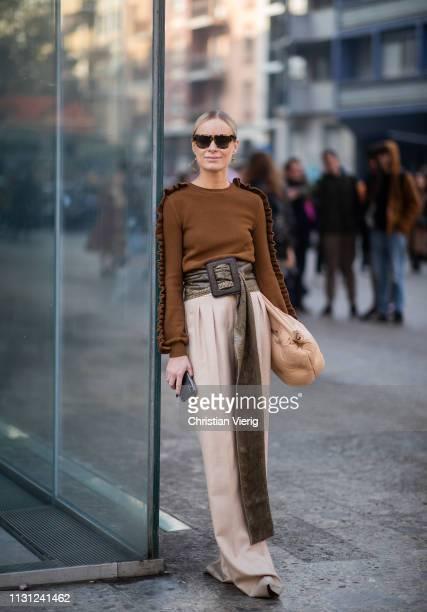 Thora Valdimars is seen wearing beige clutch brown jumper belt with print wide leg pants outside Max Mara on Day 2 Milan Fashion Week Autumn/Winter...