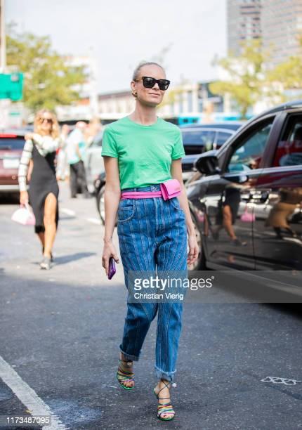 Thora Valdimars is seen wearing green shirt denim jeans pink Jacquemus mini bag during New York Fashion Week September 2019 on September 09 2019 in...