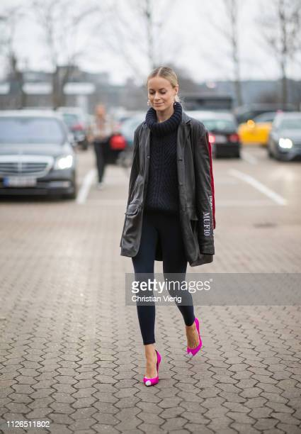Thora Valdimars is seen wearing navy turtleneck leggings pink heels MUF10 jacket outside Munthe during the Copenhagen Fashion Week Autumn/Winter 2019...