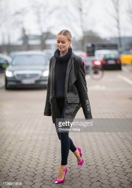 Thora Valdimars is seen wearing navy turtleneck leggings pink heels MUF10 jacket outside Munthe during the Copenhagen Fashion Week Autumn/Winter 2019...