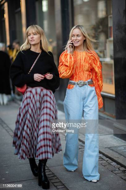 Thora Valdimars is seen wearing orange top ripped denim jeans and Jeanette Friis Madsen wearing skirt with print black knit outside Mykke Hofmann...