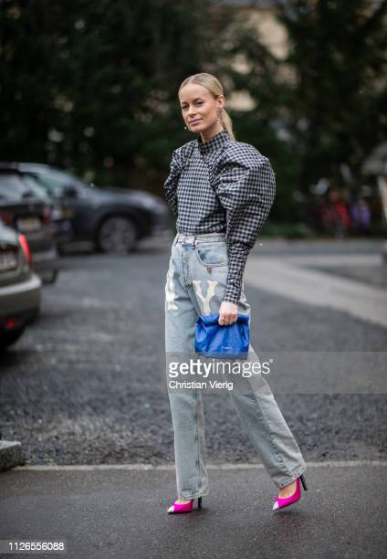 Thora Valdimars is seen wearing plaid top with wide sleeves high waist denim jeans outside By Malene Briger during the Copenhagen Fashion Week...