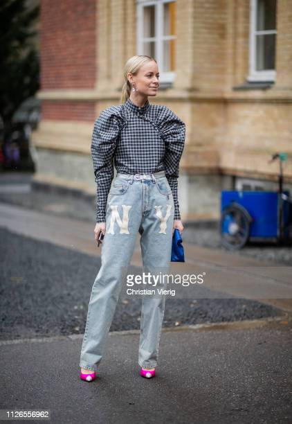 Thora Valdimars is seen wearing plaid top with wide sleeves, high waist denim jeans outside By Malene Briger during the Copenhagen Fashion Week...