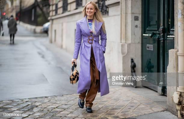 Thora Valdimars is seen wearing purple coat outside Alessandra Rich during Paris Fashion Week - Womenswear Fall/Winter 2020/2021 : Day Five on...