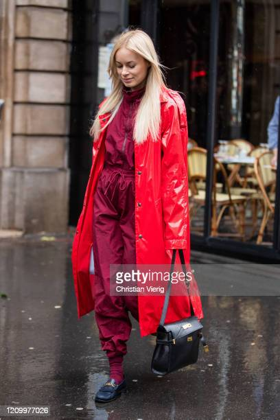 Thora Valdimars is seen wearing red varnished coat, overall, black bag outside Sacai during Paris Fashion Week - Womenswear Fall/Winter 2020/2021 :...