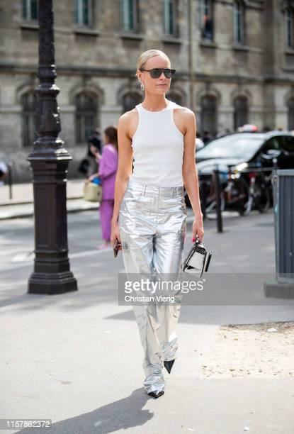 Thora Valdimars is seen wearing white top, silver pants, white Boyy bag outside Paul Smith during Paris Fashion Week - Menswear Spring/Summer 2020 on...