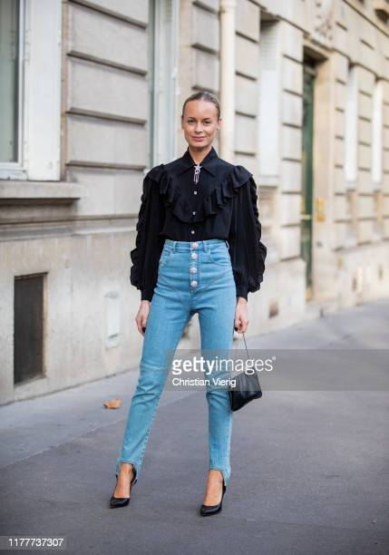 Thora Valdimars seen wearing black ruffled top, denim jeans outside Alessandra Rich during Paris Fashion Week Womenswear Spring Summer 2020 on...