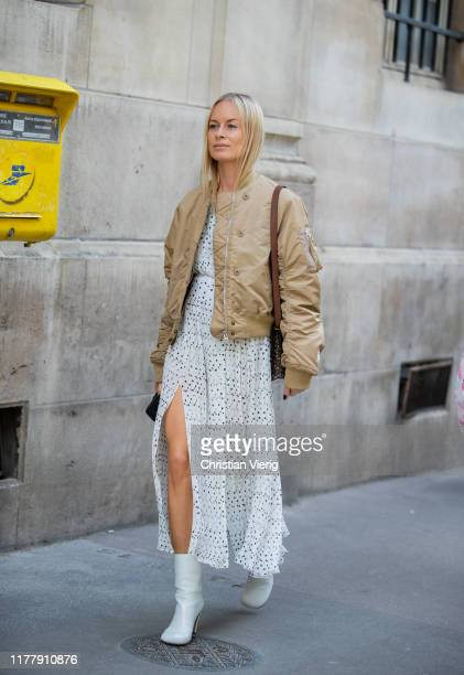 Thora Valdimars seen wearing white sheer dress beige jacket outside Cédric Charlier during Paris Fashion Week Womenswear Spring Summer 2020 on...
