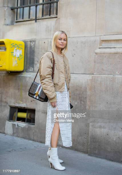 Thora Valdimars seen wearing white sheer dress, beige jacket outside Cédric Charlier during Paris Fashion Week Womenswear Spring Summer 2020 on...