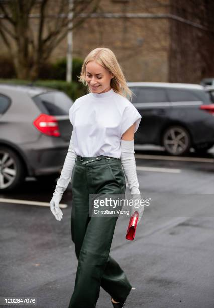 Thora Valdimars seen wearing white shirt, green pants, gloves, red bag outside Cecilie Bahnsen during Copenhagen Fashion Week Autumn/Winter 2020 Day...
