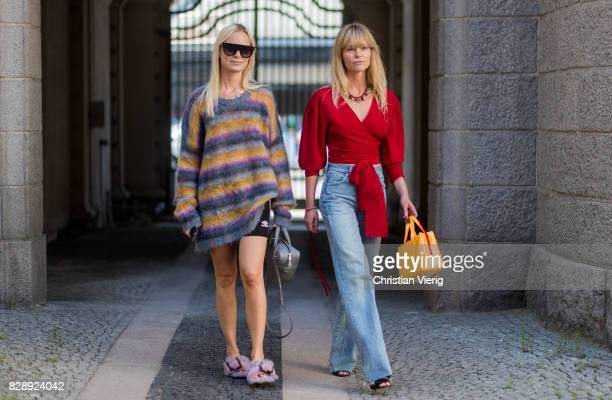 Thora Valdimars wearing Balenciaga bag and Jeanette Madsen wearing a red blouse denim jeans outside Holzweiler on August 09 2017 in Copenhagen Denmark