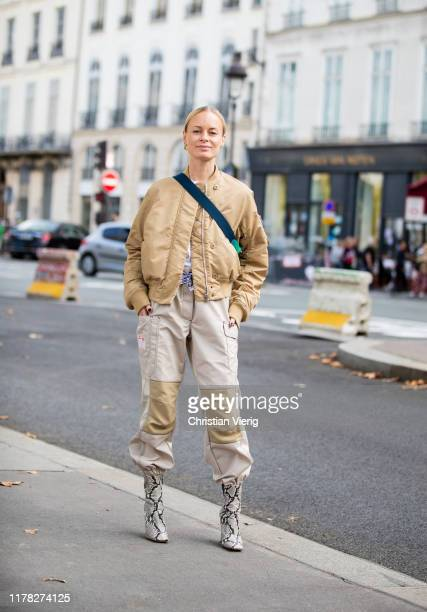 Thora Valdimars wearing beige jacket two tone pants boots with snake print outside Beautiful People during Paris Fashion Week Womenswear Spring...