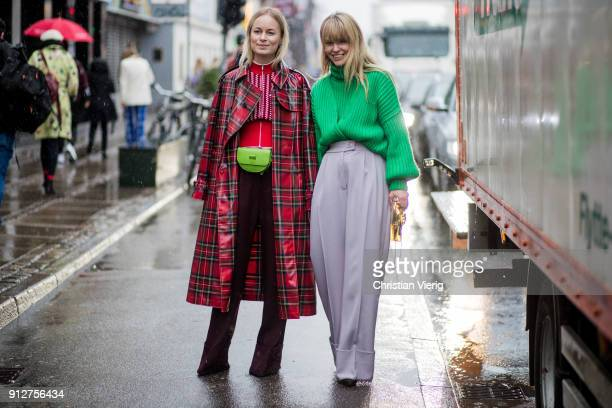 Thora Valdimars wearing green belt bag red black lumberjack coat zipped jacket and Jeanette Madsen wearing green turtleneck grey wide leg pants...