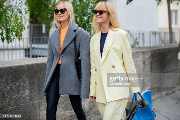 Thora Valdimars wearing grey blazer and Jeanette Friis Madsen wearing yellow suit, blue oversized bag seen outside Haider Ackermann during Paris...