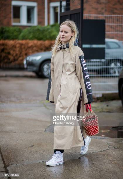 Thora Valdimars wearing MUF10 trench coat and bucket bag outside Cecilie Bahnsen during the Copenhagen Fashion Week Autumn/Winter 18 on January 31...