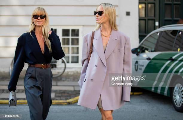 Thora Valdimars wearing oversized blazer and Jeanette Friis Madsen wearing grey high waitst pants, brown belt, navy blazer seen outside Helmstedt...