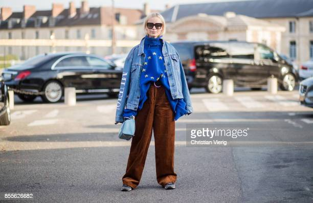 Thora Valdimars wearing oversized blue hoody with European Union print denim jacket brown corduroy pants is seen outside Loewe during Paris Fashion...