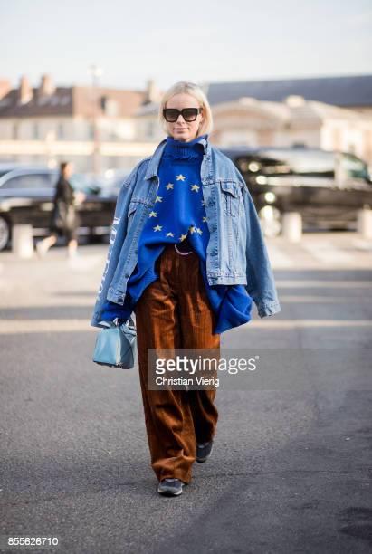 Thora Valdimars wearing oversized blue hoody with European Union print denim jacket brown corduroy pants is seen outside Loewe during Paris Fashion...