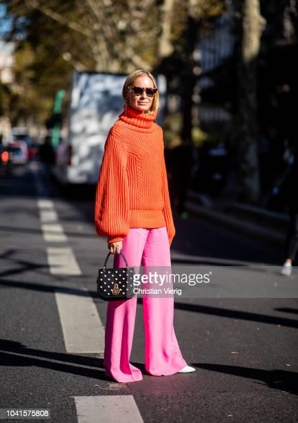 Thora Valdimars wearing red turtleneck pink pants is seen outside Guy Laroche during Paris Fashion Week Womenswear Spring/Summer 2019 on September 26...