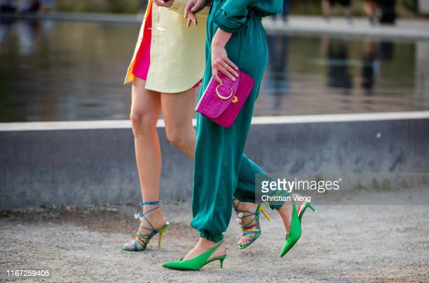 Thora Valdimars wearing yellow button shirt and Jeanette Madsen wearing overall pink Chloe bag is seen outside Samsøe Samsøe during Copenhagen...