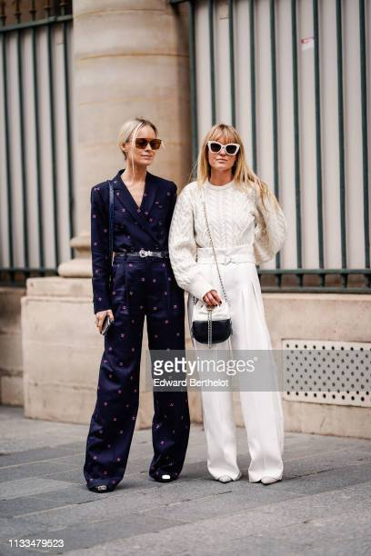 Thora Valdimars wears a floral print blazer jacket a belt Jeanette Madsen wears sunglasses a white wool pullover flared pants a Chanel bag outside...